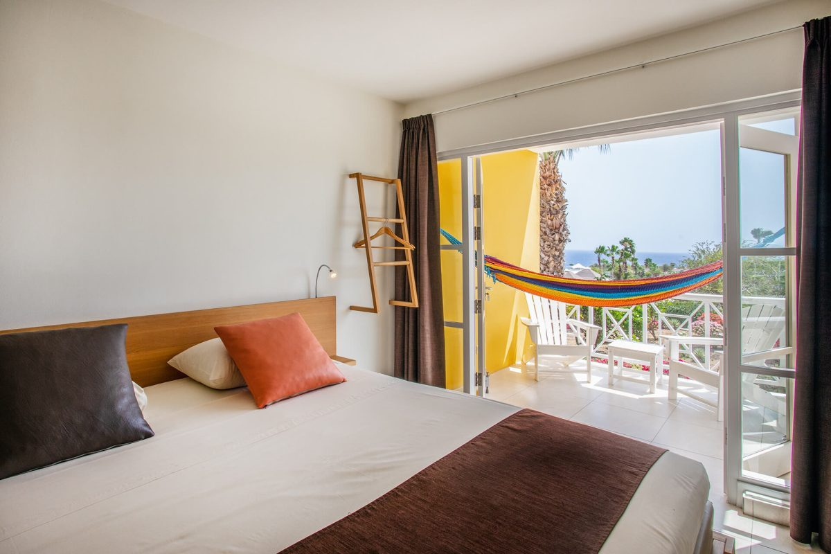 The Chogogo Curacao studio with a double bed and terrace.