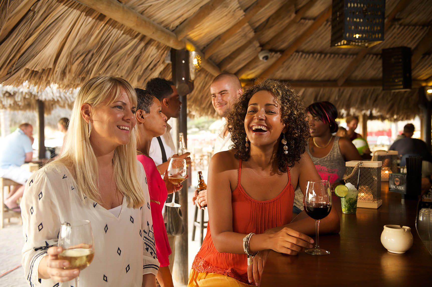 Visitors at the Zanzibar beach and Restaurant are having a good time.