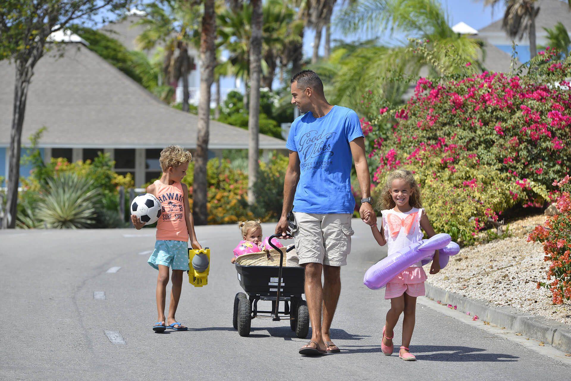 A family enjoying their rental beach cart at Chogogo Curacao.