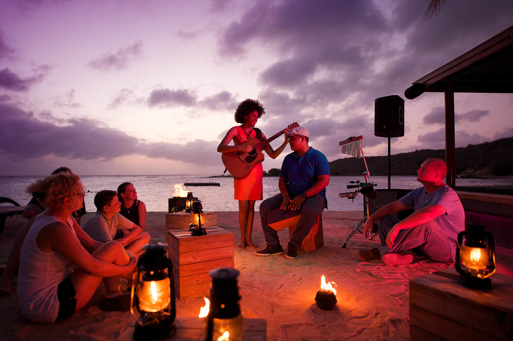 Visitors enjoying a night at Zanzibar's popular happy hour with live music.