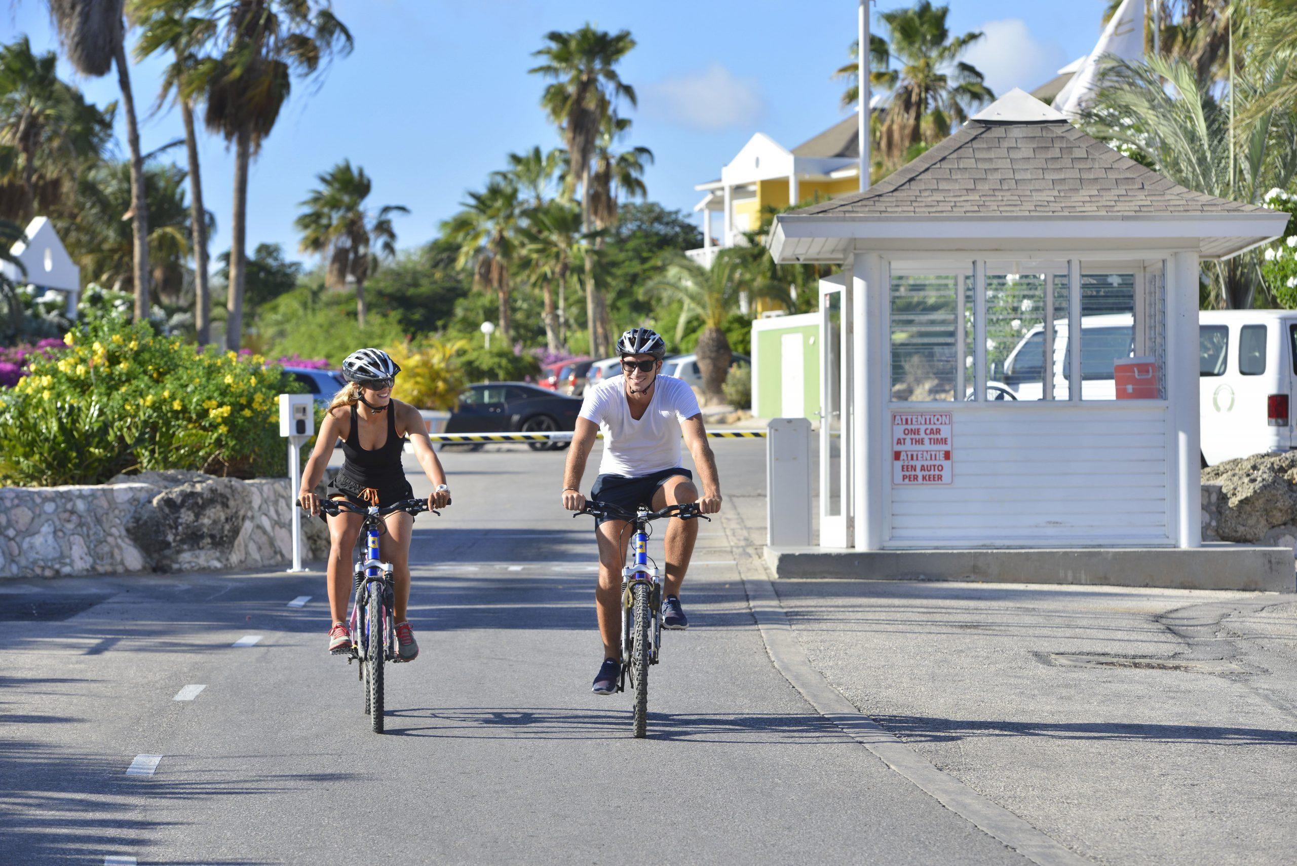 Tourists riding a rental bike at Chogogo Curacao.